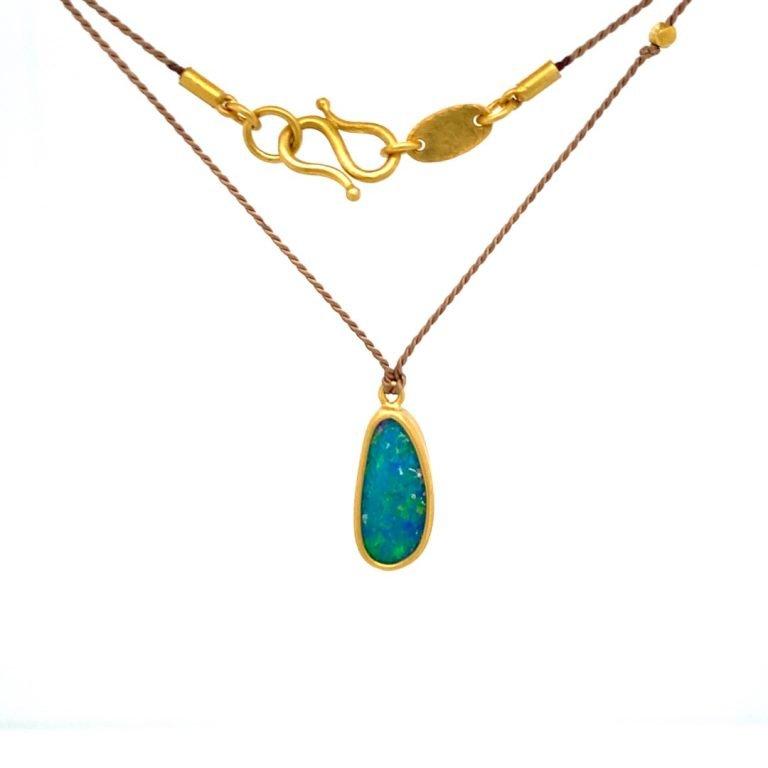 22 Karat Gold Framed Blue Opal On Silk