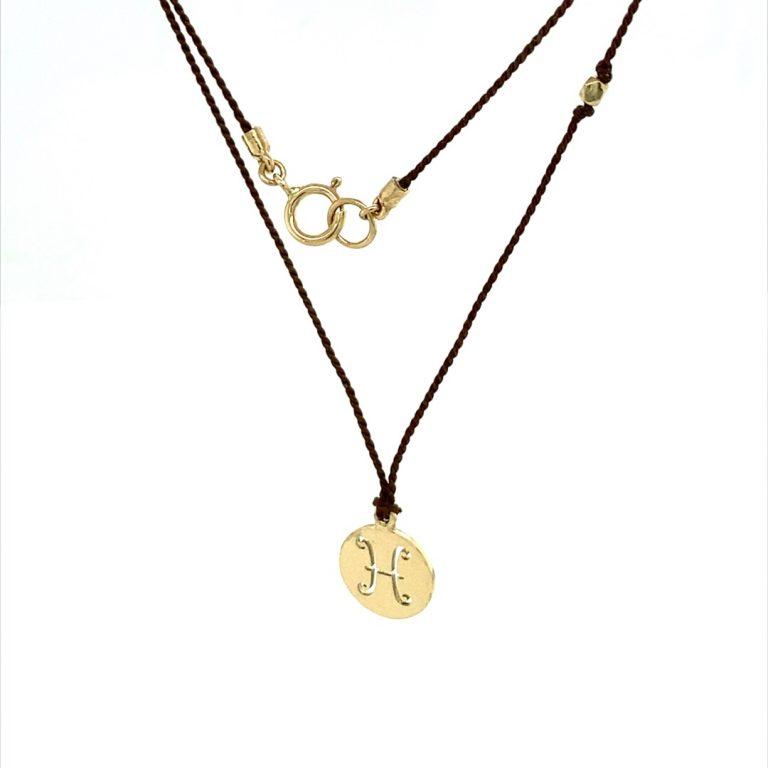 14 Karat Gold Pisces Zodiac Charm On Brown Silk