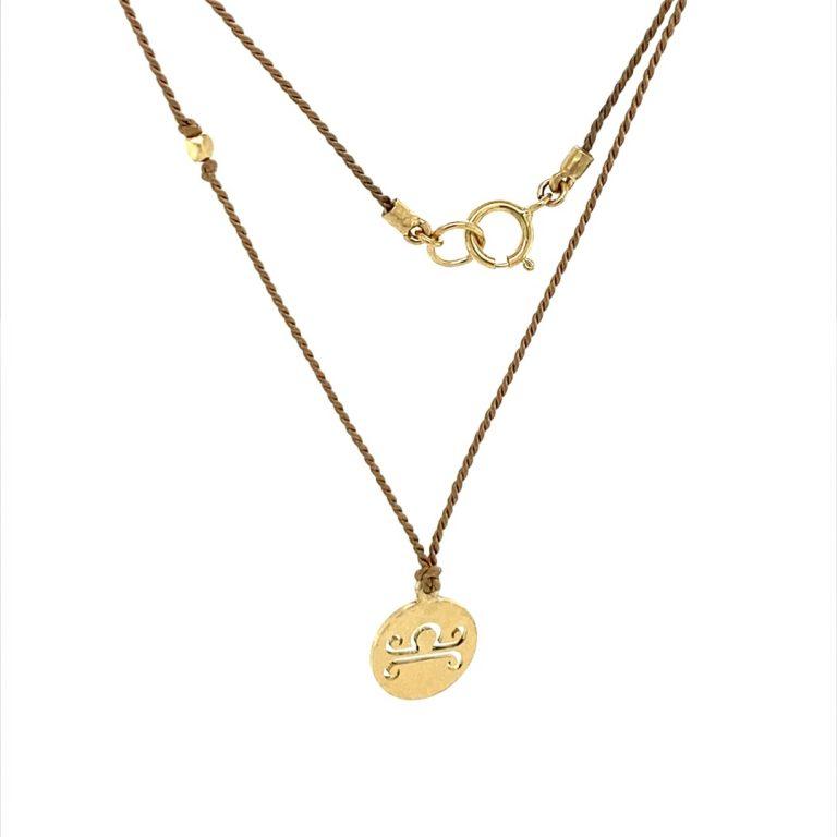 14 Karat Gold Libra Zodiac Charm On Light Brown Silk