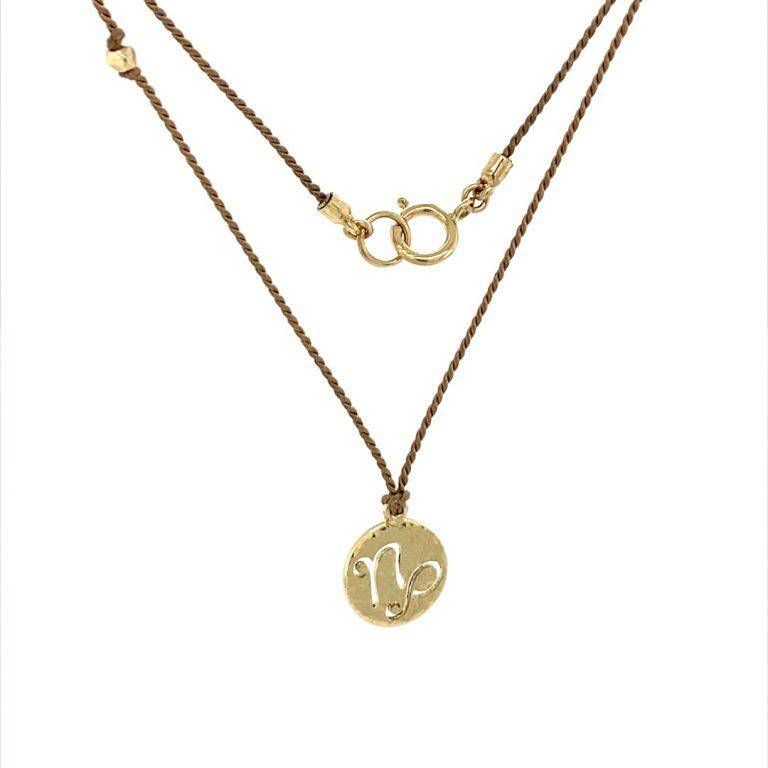 14 Karat Gold Capricorn Zodiac Charm On Light Brown Silk