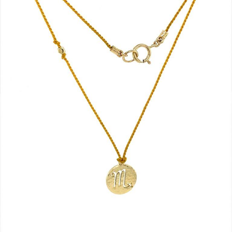 14 Karat Gold Scorpio Zodiac Charm On Yellow Silk